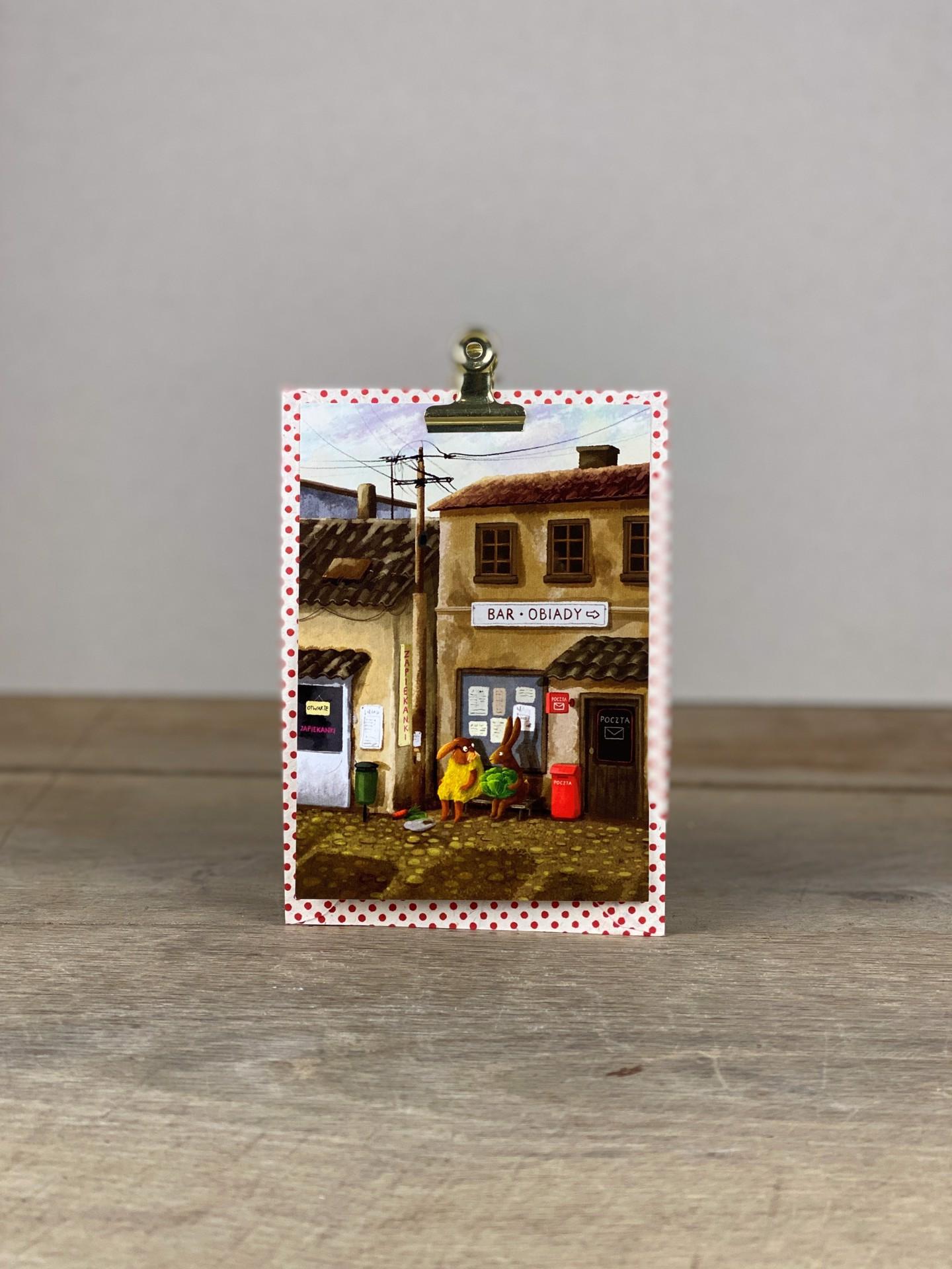 Postkarte Osterhasen auf Bank